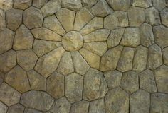 Stones included in Wall make the shape of a flower, showing the craftmanship and artistic idea of the builder. Stones included in Wall make the shape of a stock photos