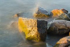 Stones of jetty at sunset Royalty Free Stock Photos