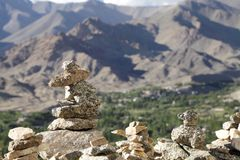 Stones kept on the wall of Tsemo monastery with a beautiful view at the backdrop Stock Image