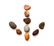 Stones laid out in the form of an arrow. Stock Image