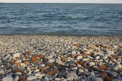 Stones and the lake shore. Beach backgrouns royalty free stock photography