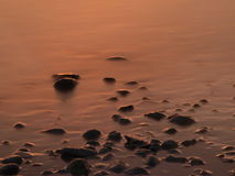 Stones in a lake. Some stones in the lake Constance with a wonderful sunset Royalty Free Stock Photos