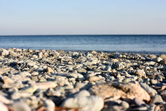 Stones. Landscape with rocks and sand, on a sunny day with clear sky Royalty Free Stock Images