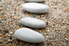 Stones lie on  sand Stock Photography