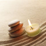 Stones and light candle Royalty Free Stock Photos