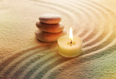 Stones and light candle Royalty Free Stock Photo