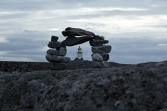 Stones and light house Royalty Free Stock Photo