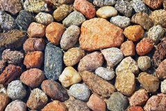 Stones. The stones lying at the bottom of the artificial stream. They give the impression of naturalness. Water flows with the speed and creates a unique game of Royalty Free Stock Image