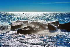 Stones in the Mediterranean Sea with waves splashes Royalty Free Stock Photography