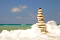 Stones in meerschaum. Stones alone in a beautiful beach in the coast of Cyprus Royalty Free Stock Photos