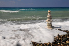 Stones in meerschaum. Stones alone in a beautiful beach in the coast of Cyprus Stock Photos