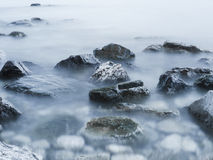 Stones in the mist. Stones in the sea white mist Stock Photo