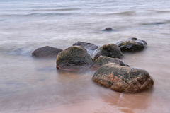 Stones and mist. Big stones in the sea covered with mist Royalty Free Stock Photo