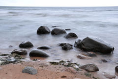 Stones and mist. Big stones in the sea covered with mist Royalty Free Stock Photography