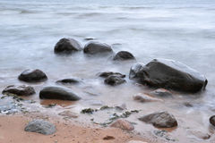 Stones and mist. Big stones in the sea covered with mist Royalty Free Stock Images