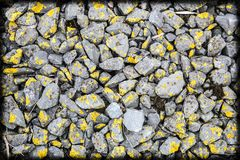 Stones with moss on a railroad track stock photography