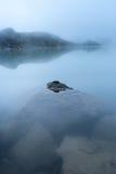 Stones in mountain lake Stock Image
