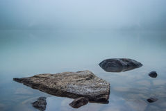 Stones in mountain lake Royalty Free Stock Images