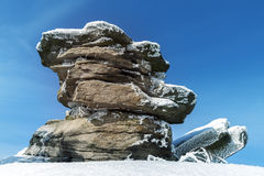 Stones on Mountain Peak Covered with Frost. And Blue Sky royalty free stock images