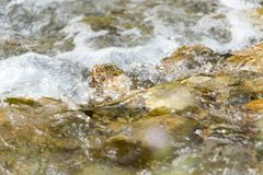 Stones in the mountain river. Photo of abstract textures Stock Photo