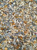 The stones are multicolored, background and texture for images. On the surface are colored stones, large pebbles. Use as background, building material royalty free stock image