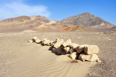 Stones on Nazca desert. Nazca desert with stones on foreground and mountains on background royalty free stock photos