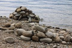 Stones near water. There stones near water on the picture Royalty Free Stock Photo