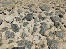 Stones at the north sea coast. Stones on the North Sea coast in Bremerhaven, Germany royalty free stock photo