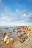 Stones in the ocean. The Baltic Sea coast, Poland. Royalty Free Stock Photos