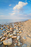 Stones at the ocean beach. The Baltic Sea coast. Stock Photography