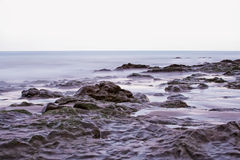 Stones in the ocean near canarian shore. Royalty Free Stock Photos