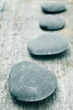 Stones on an old wooden surface Stock Photos