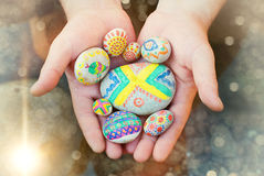 Stones with ornaments. Kids Hands with Stones. Art. Conceptual idea Royalty Free Stock Images