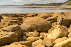 Osmington Bay, Jurassic Coast, Dorset, UK. Stones at Osmington Bay, Osmington Mills, near Weymouth, Jurassic Coast, Dorset, UK Royalty Free Stock Photography