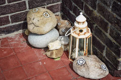 Stones with painted eyes. Stock Image