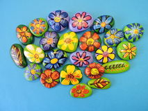 Stones with painted flowers and leaves Stock Photography
