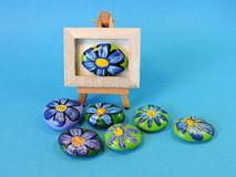 Stones with painted flowers Stock Photography