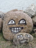 Stones with painted happy faces Royalty Free Stock Photos