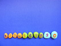 Stones with painted numbers Royalty Free Stock Images