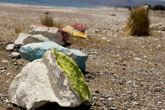 Stones painted with paint. On the seashore stock photo