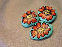 Stones with painted red  flowers Stock Images