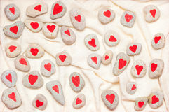 Stones painted with red hearts Stock Image