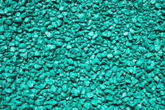 Stones painted in turquoise color. Decorative gravel. Turquoise pebble background texture Stock Photography