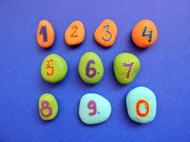 Stones with painting numbers Stock Photos