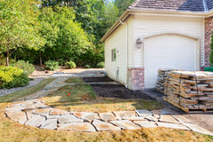 Stones for path placed to patio edge Stock Photo