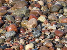 Stones and pebbles on the beach Stock Images
