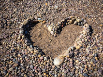 Stones and pebbles form heart shape Stock Photography