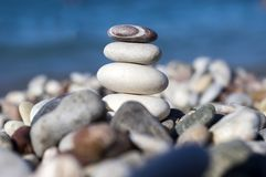 Stones and pebbles stack on seacoast. Stones and pebbles stack, harmony and balance, one stone cairn on seacoast Royalty Free Stock Photography