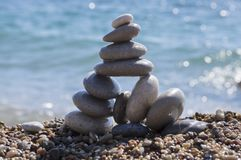 Stones and pebbles stack, harmony and balance. One big pyramid stone cairn on seacoast Royalty Free Stock Image