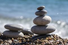 Stones and pebbles stack, harmony and balance, two stone cairns on seacoast. Stability towers Royalty Free Stock Photography